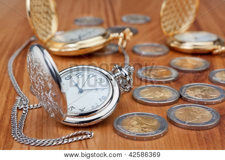 Group Pocket Watch Against The Background Of Euro Coins.