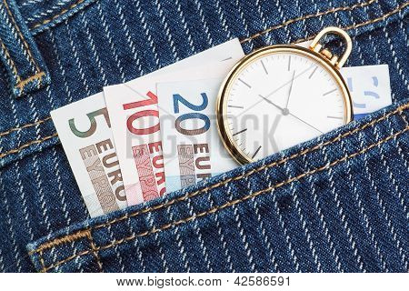 Pocket Watch In Your Pants And Jeans With Money Euro. Closeup.