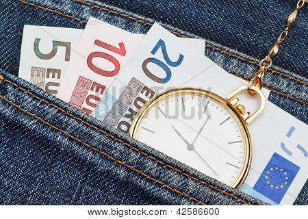 Pocket Watch With Chain In Jeans And Money Euro. Close-up.