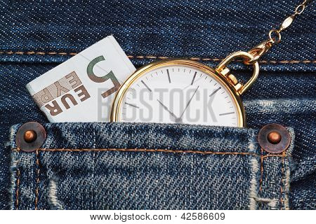 Pocket Watch With Chain In Jeans And Five Euros. Close-up.