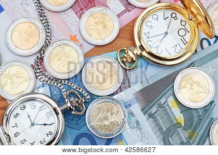 Pocket Watches And Euro Money.