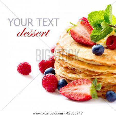 Pancake. Crepes With Berries. Pancakes stack with Strawberry, Raspberry, Blueberry and Syrupe isolated on a White Background