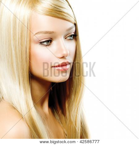 Beauty Girl Portrait with Long Blonde Hair. Blond Woman isolated on White Background. Extension. Hairstyle. Highlights