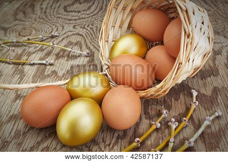 Group Gold Eggs Spilled Out Of A Basket. At Easter.
