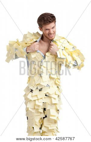 The young male covered with yellow sticky notes, isolated on white background