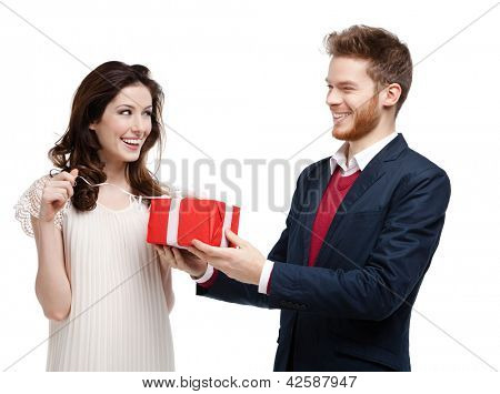 Man gives present wrapped in red paper to his girlfriend, isolated on white