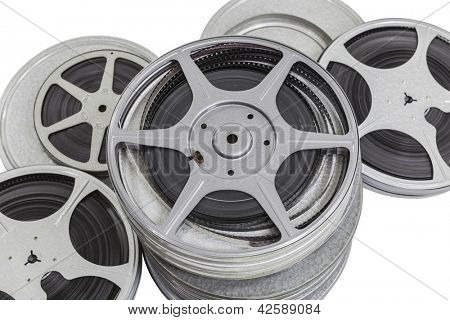 Vintage pile of 8mm film cans isolated on white.