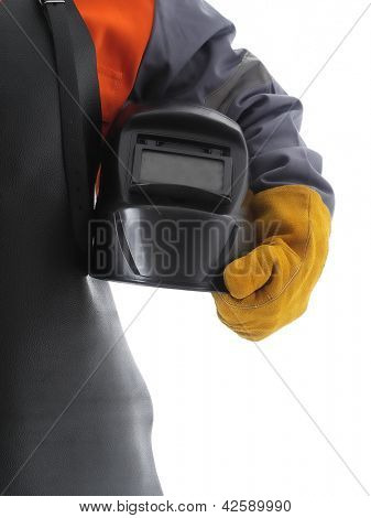 Body shot of welder wearing protective welding leather apron and glove holding welding hood over white