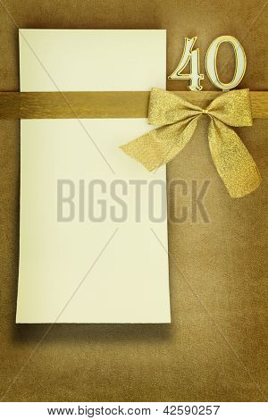Anniversary card on golden background