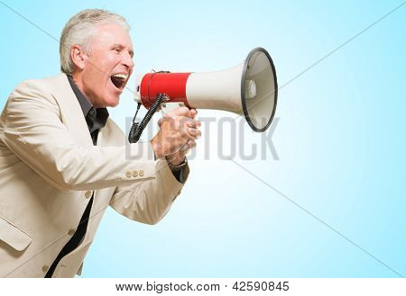 Angry Businessman Shouting In Megaphone against a blue background