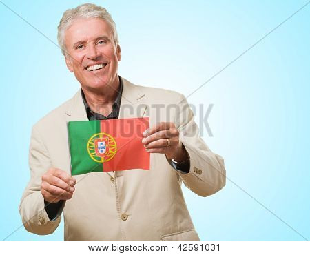 Businessman Holding The Flag Of Portugal against a blue background