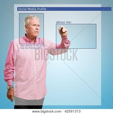Mature Man Filling Form On Social Network On Blue Background