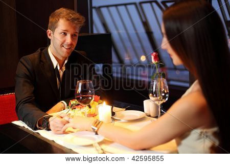 The restaurant guy holding a beautiful Brunette by the hand