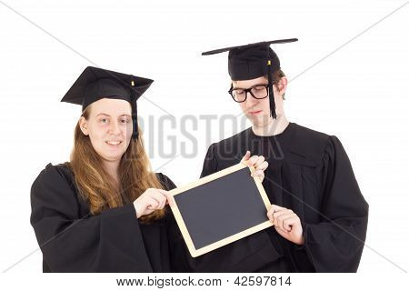 Two Graduates In Their Academic Gowns