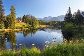 stock photo of ponds  - Nature mountain scene with beautiful lake in Slovakia Tatra - Strbske pleso