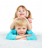 Family portrait, cheerful brother and sister lying on the floor