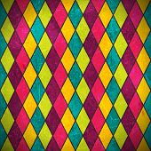 Geometric pattern made of rhombuses in various bright colors overlaid with grunge elements and scrat
