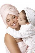 image of bathtime  - Beautiful little girl kissing her smiling mother after bathtime - JPG