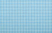 stock photo of tartan plaid  - blue checkered fabric closeup tablecloth texture - JPG