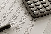 Financial Spreadsheet with Pen and Calculator