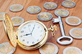 stock photo of watch  - Gold pocket watch on the background euro coins and keys - JPG