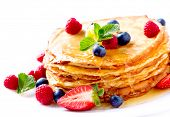 Pancake. Crepes With Berries. Pancakes stack with Strawberry, Raspberry, Blueberry and Syrupe isolat