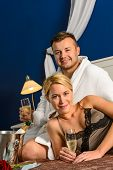 stock photo of nightgown  - Intimate affair bed young couple drinking champagne woman nightgown - JPG