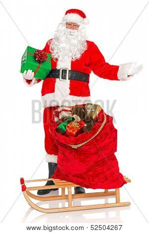Santa Claus or Father Christmas with a sack full of gift wrapped toys and presents on a sled, isolated on a white background.