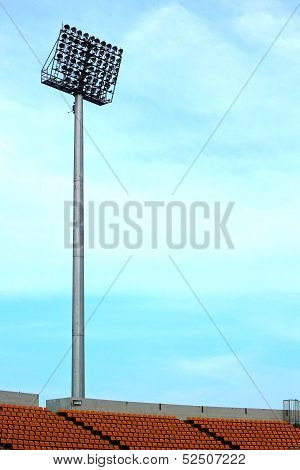 Seat Grandstand Is Empty Stadium With A Light Pole.