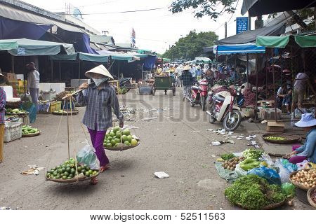 Unidentified street vendor at a market