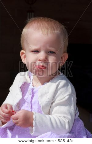 Baby Girl In Dress Being Expression