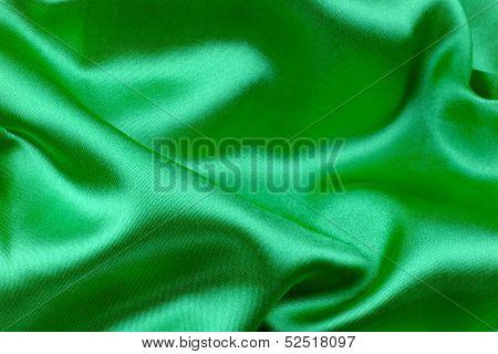 Green wavy silk fabric.