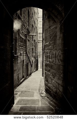 Borthwick's Close, a typical alleyway in Edinburgh, Scotland. Sepia toned vintage effect.
