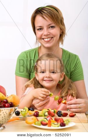 Woman And Little Girl Making Fruit Kebab