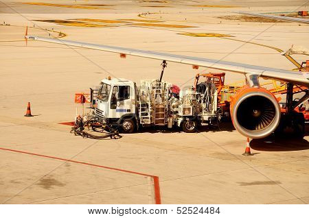 Airbus being re-fuelled, Malaga, Spain.