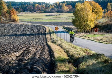 Riding uphill during autumn