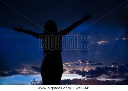 Meditating Woman To Clouds Sky