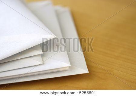 Envelopes On Desk Ii