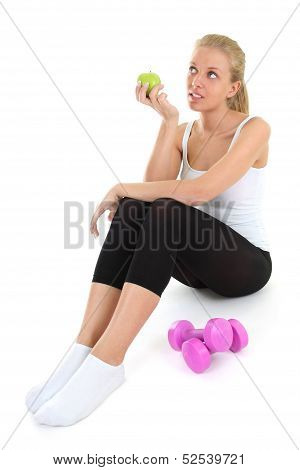 Dreaming Blondie Woman Sitting With Dumbbells And Apple