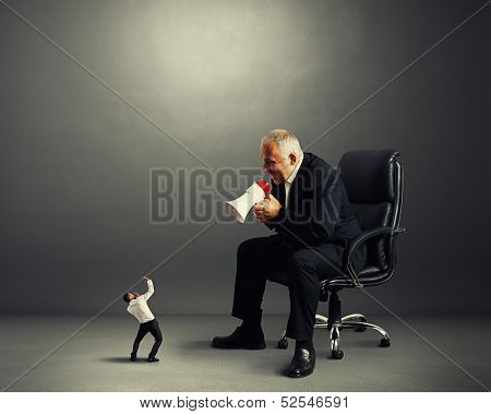 big boss screaming at small businessman