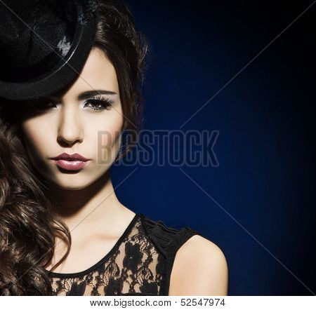 Portrait of young and beautiful woman in retro style