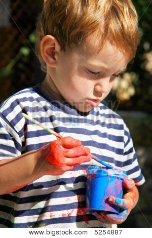 Young Boy Ready To Paint Outdoors Portrait