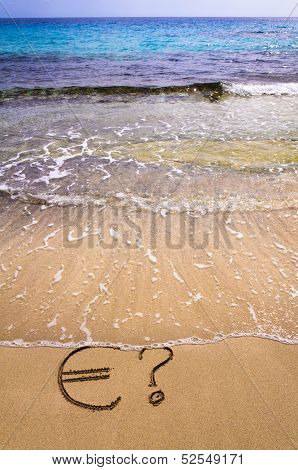 Euro Sign And Question Mark In The Sand, Washed Away By Sea Water