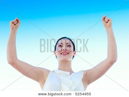 Young Businesswoman Outdoors Against Blue Sky