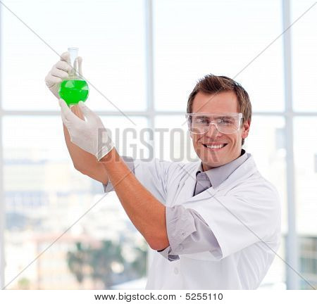 Scientist Examining A Test-tube Smiling At The Camera