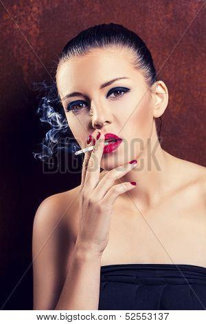 Close-up portrait of smoking girl
