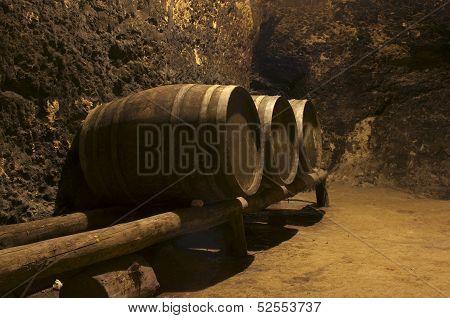 Row Of Wine Tuns On Wooden Platform Underground