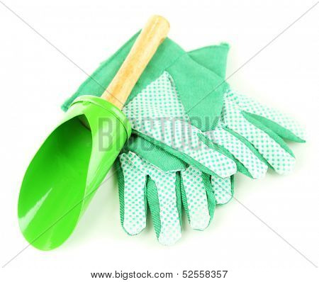 Small gardening shovel and gloves isolated on white