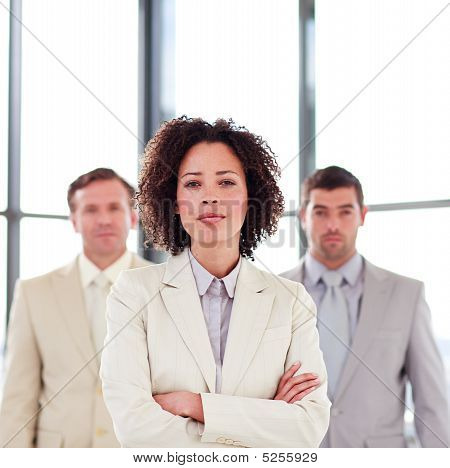 Serious Young Businesswoman With Folded Arms