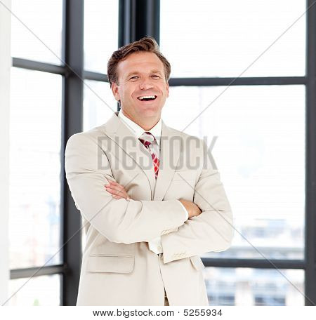 Business Leader With Folded Arms Smiling At The Camera